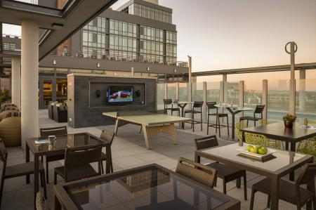 Residents Relaxing on the Sun Deck | Apartments for rent in Arlington, VA | Parc Meridian at Eisenhower Station